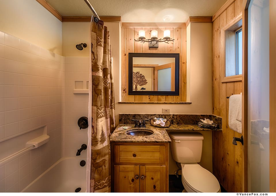 Bathtub, granite counter-top.