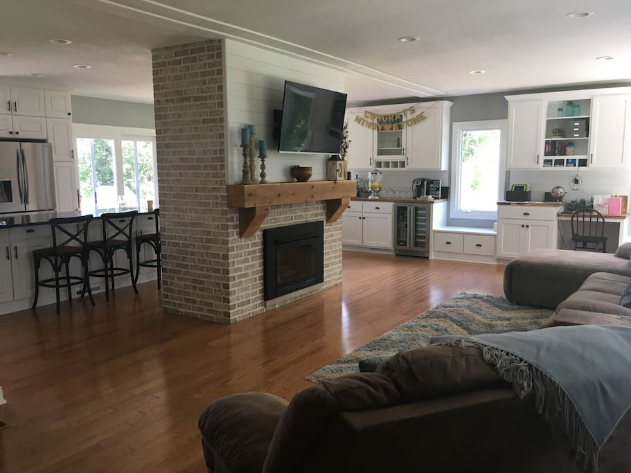 living room and fireplace into kitchen