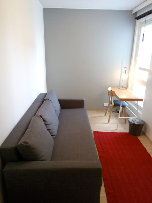 Your room with fold out double sofa bed for 2 people and desk for working.