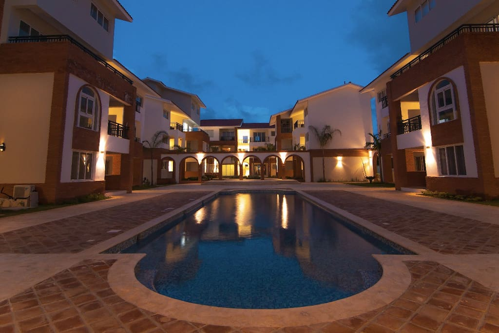 A stunning poolside view of Coral Village just after sunset