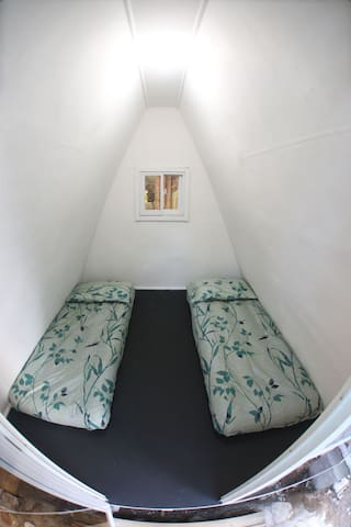 Two single beds for Tipi 2 and 3 for the kids or Yaya or whoever may tag along