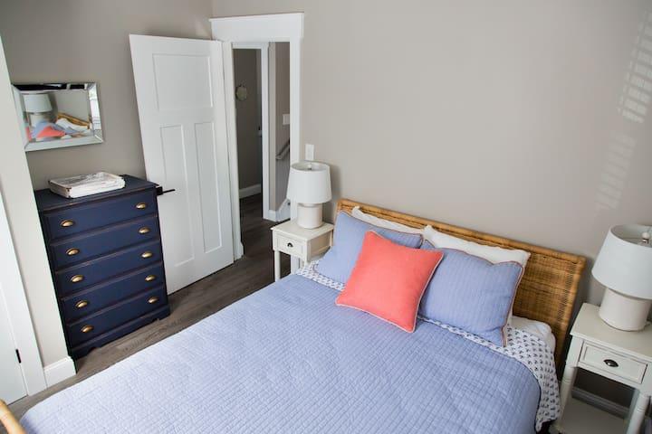 Bedroom 1: Queen Bed, closet and dresser.