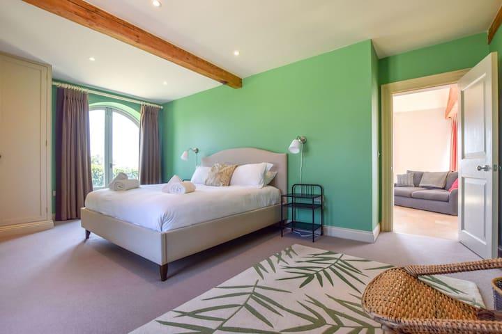 Bedroom 1 looking towards open plan living area