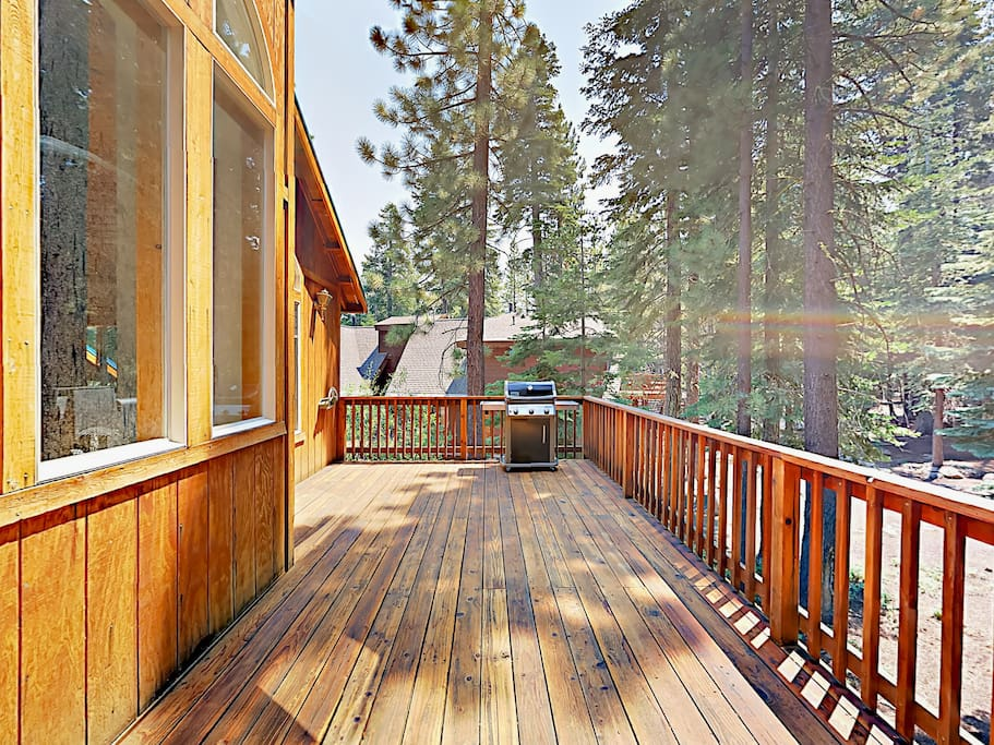 The roomy deck overlooks the wooded property.