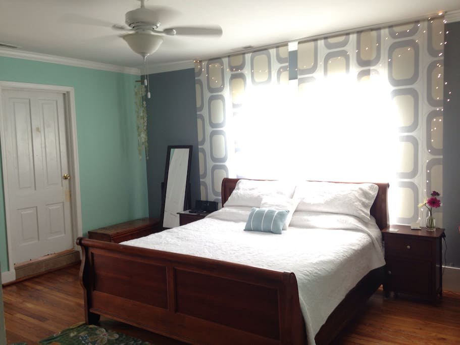 Master bedroom with king bed, also has a flatscreen TV, streaming services, and DVD player.