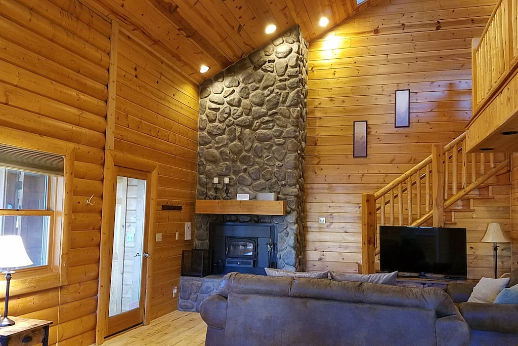 Living Room has a Wood Burning Fireplace, Sofa Sleeper, Dish Satellite and Wi-Fi.