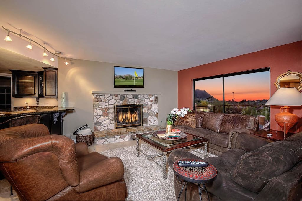 Living Room connects to the large gourmet kitchen overlooking the views and the back yard!