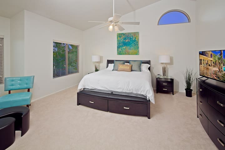 High vaulted ceilings in master bedroom with private bathroom and TV. Located Upstairs.