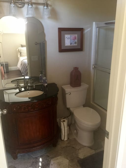 newly remodeled private bathroom wit shower and tub
