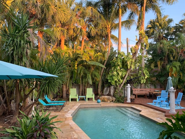 Little piece of paradise near Hollywood Beach.  Private home with lushly landscaped  A private resort-style tropical oasis around large pool.open concept kitchen w/center island & marble counters.