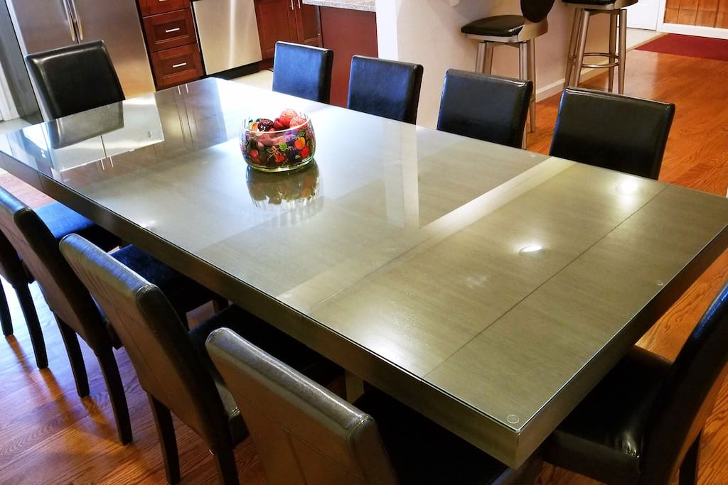 Our newly updated, modern & sleek dining table is perfect for large groups to enjoy! Table fits 10-12 guests and kitchen island accommodates an additional 4!