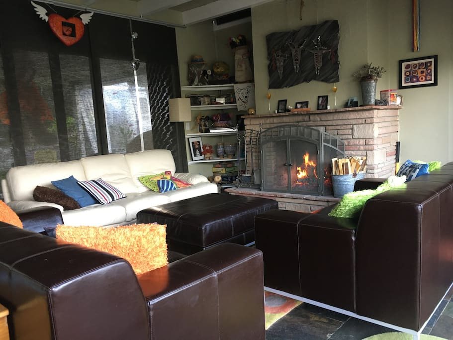 Living room with a fireplace.  Great for gatherings or quiet time by the fire!