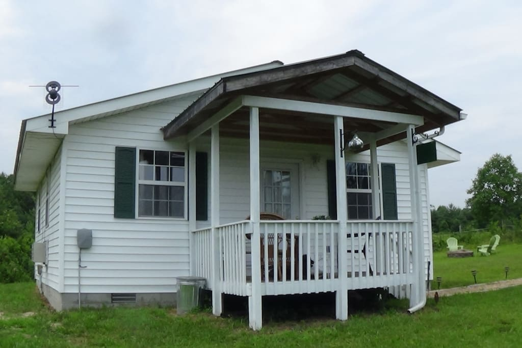 Guest House with front porch and seating.