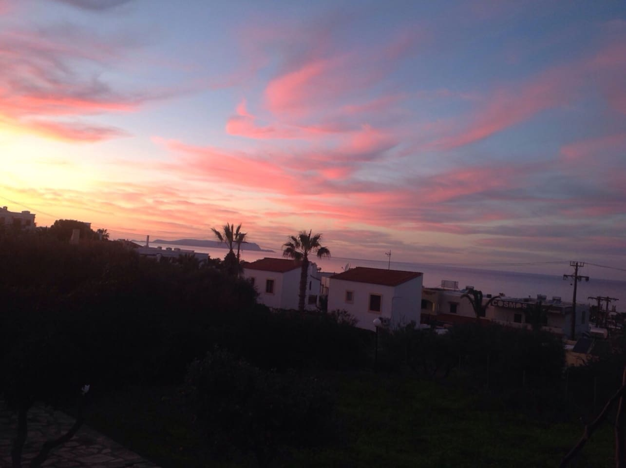 Sunset to the sea, panoramic view from the garden