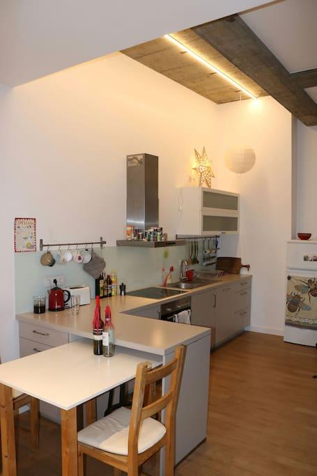 Kitchen: includes refrigerator and freezer storage, breakfast bar, and dishwasher