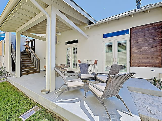 Unwind into vacation mode on the front patio, featuring four lounge chairs and a firepit.
