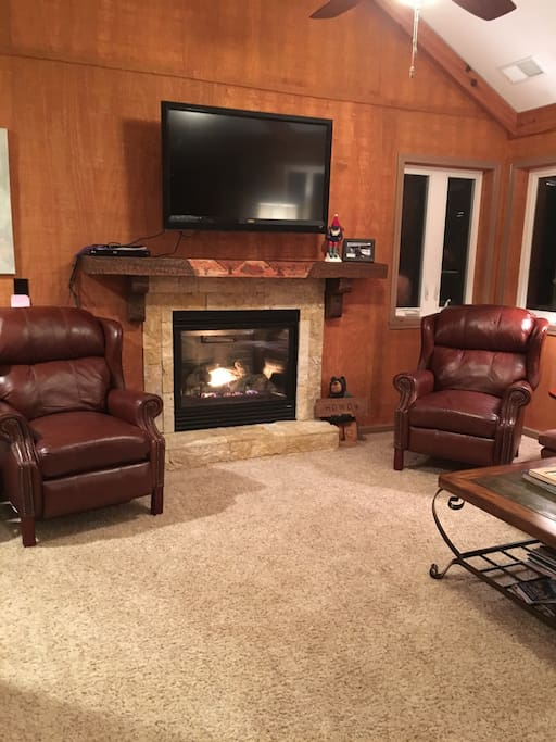 Fire place with TV - and a ROKU box for streaming unlimited movies and TV shows.