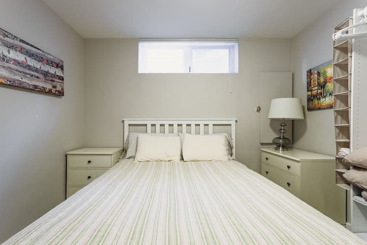 Bright and cheery bedroom within the suite