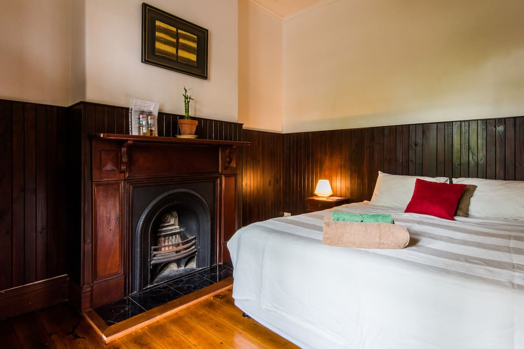 Bedroom and wooden wall panelling