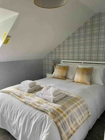 Upstairs bedroom with Double bed & plenty of storage. There are beautiful views of the garden & fields beyond from the window.