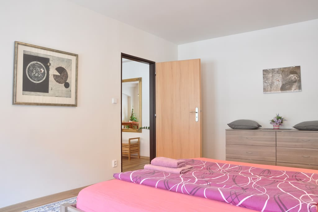 Master bedroom with queen-size bed is very quiet and private. Other bedroom with double bed is in the opposite side of the apartment.