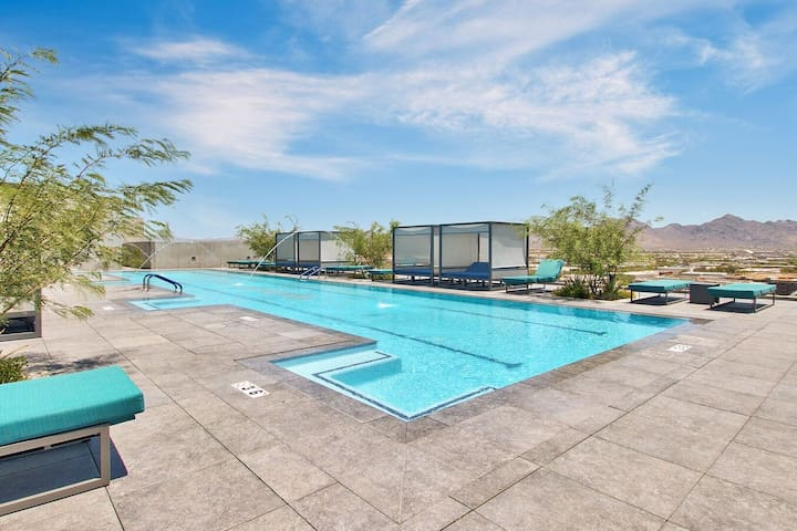 Guests have shared access to a glittering pool with cushioned sun loungers.