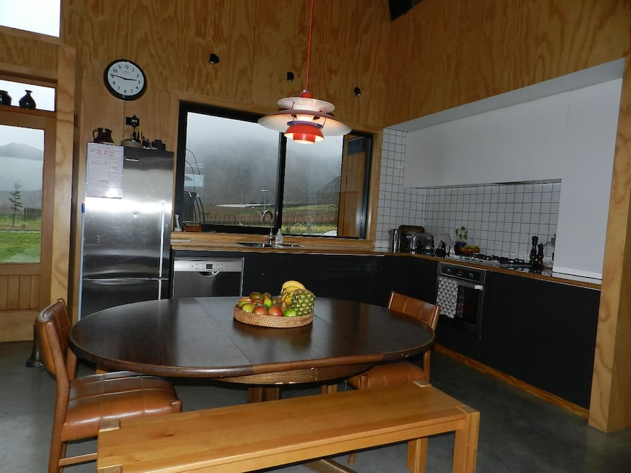 Open plan dining and kitchen area. Spacious kitchen.