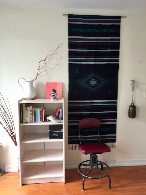 Reading nook: Bookshelf, art, vintage cushioned drafting chair