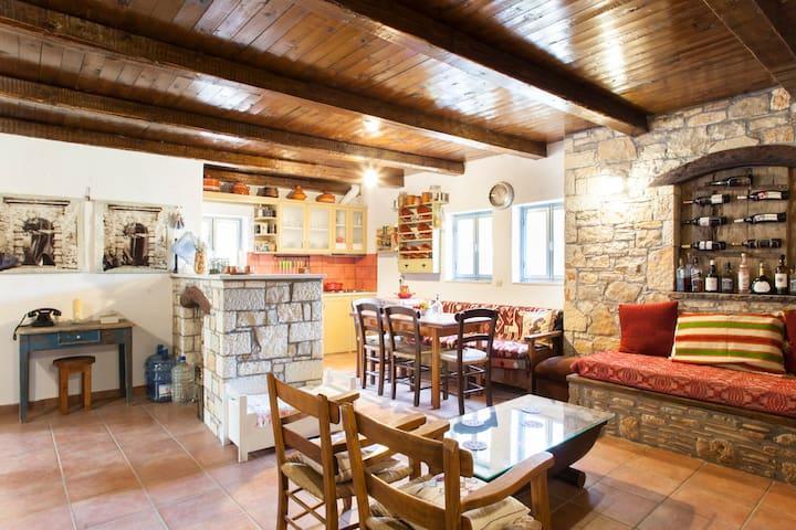 Traditional ecosolar stone home in pristine nature