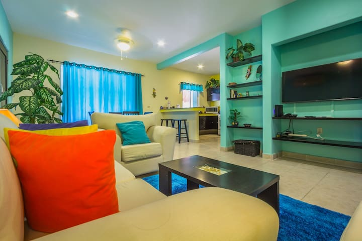 The living space with large smart TV and comfortable seating.