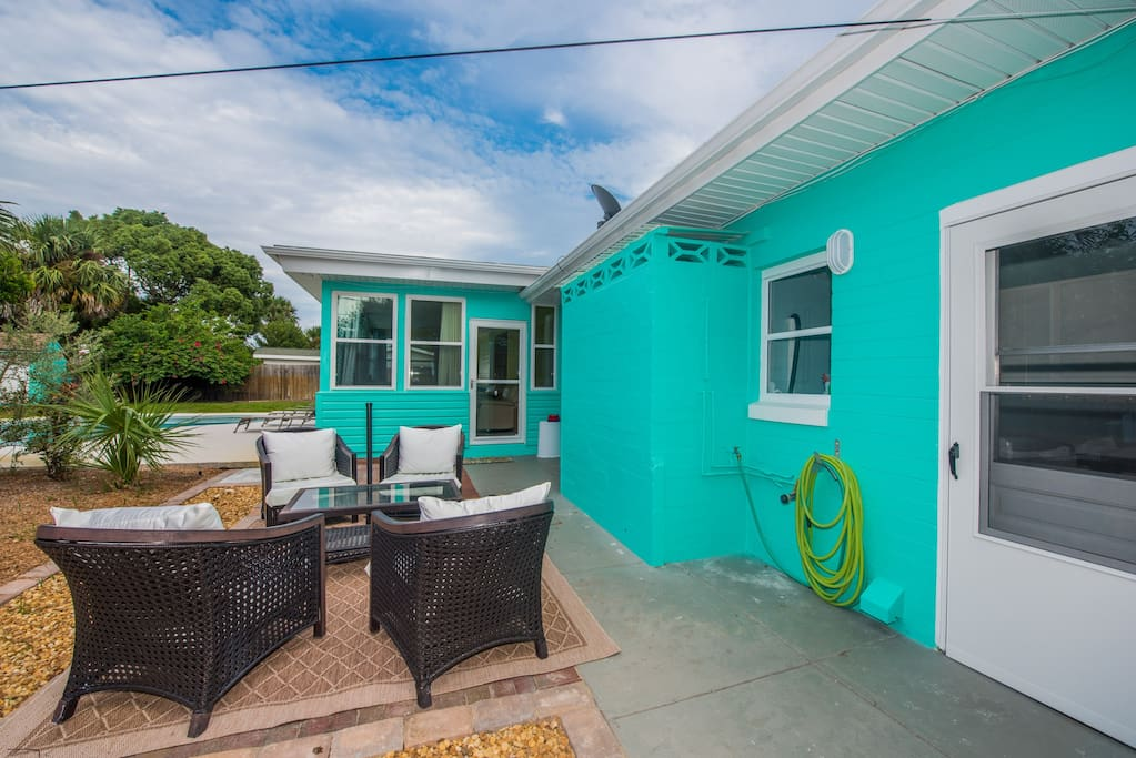 Patio with lots of seating, BBQ grill, enclosed outdoor shower