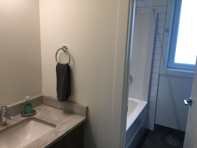 Second floor bathroom with separate room for shower/tub and separate toilet room