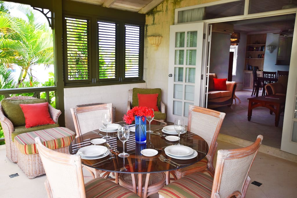 A lovely veranda with an additional al fresco dining option, and comfortable lounge chairs