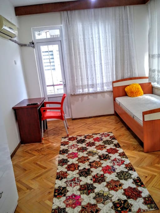 First room (30m2) has single size bed and quite a big couch (can become a double size bed). Also including wardrobe, carpet, air condition, one desk, one chair, LED TV with satellite channels and you will have your own big balcony.  First room $100p/w    Bond fee: 2 weeks rent fees  Minimum stay: 2 months