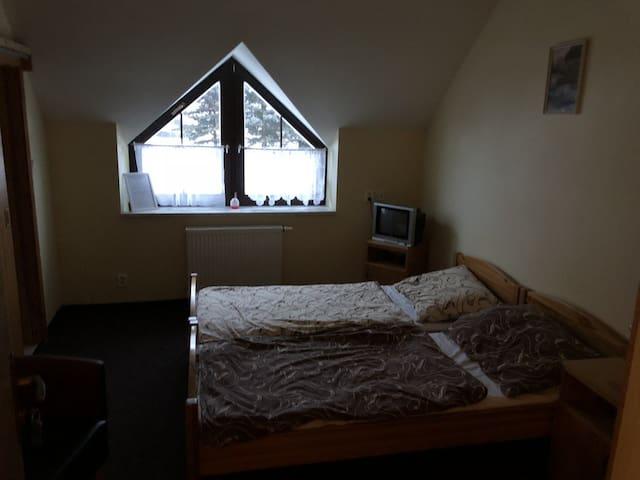 Dvoulůžkový pokoj v penzionu Tetřívek