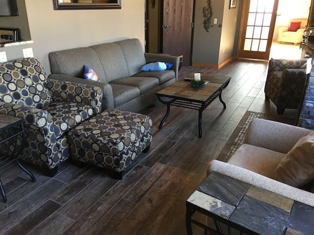2017 updated flooring in the living room.  Please note that the rest of the photos of the living room still show the old carpet that is no longer there.