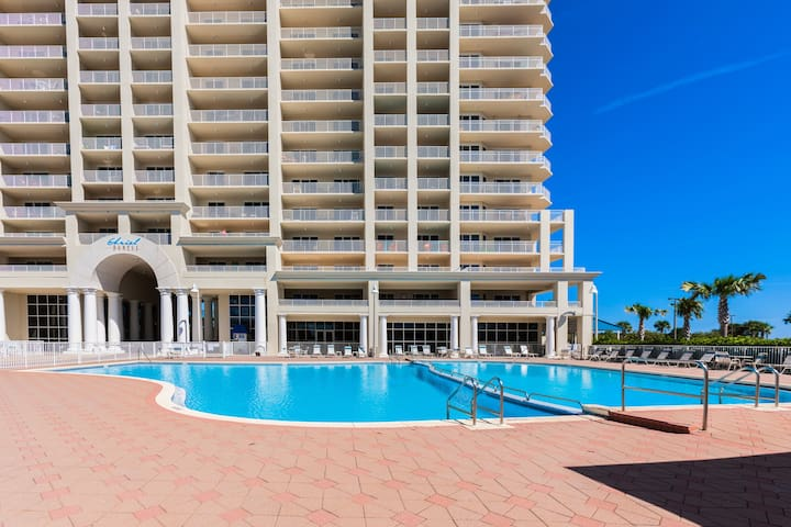 Enjoy luxe amenities during your stay, like a sparkling pool.