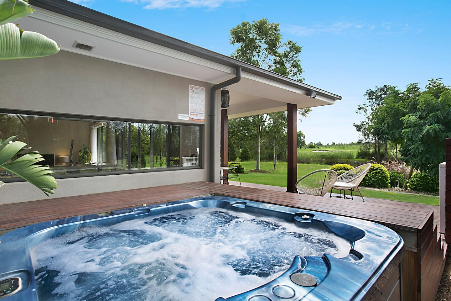 Heated spa with golf and vineyard views