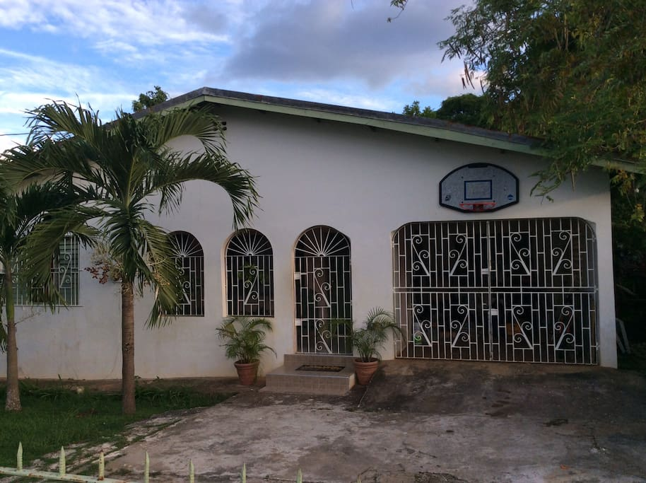 The rustic front view of My Father's Works Jamaica.