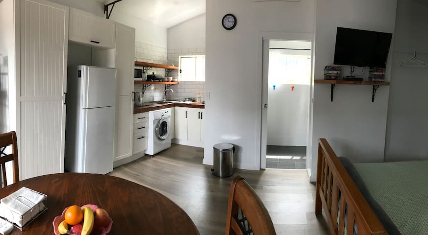 Light airy space kitchenette and front load washer/dryer takes awhile. Pantry has some breakfast cereals etc etc.