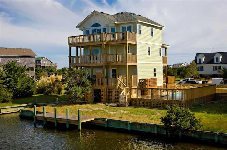 TARPON WATCH - Cozy Canalfront Avon Home-Pool, Picnic Area, Hot Tub, GameRm, Wet Bar, Boat Dock