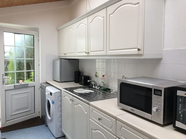 There is a fully equipped kitchen