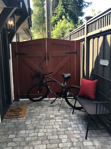 Private, level entrance from the driveway, cozy bench, and automatic solar patio light for entrances after dark. Electra cruiser with removable basket available for use.