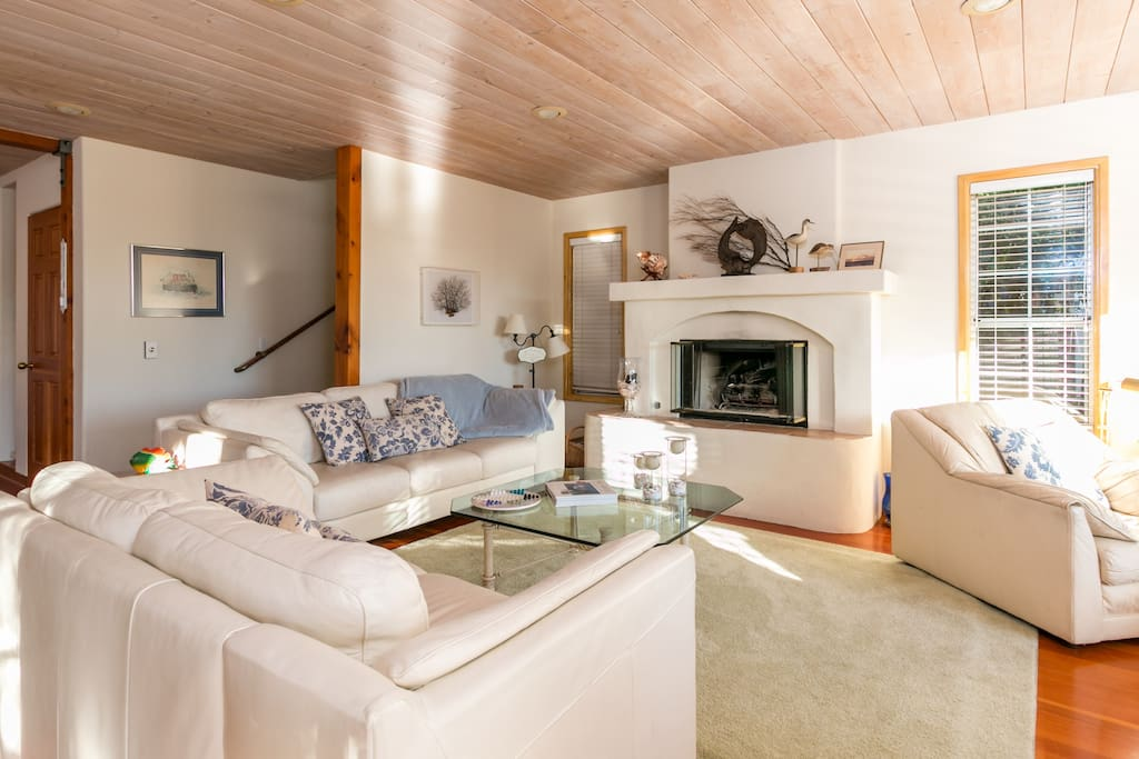 The expansive living room has plush couches and leather armchairs