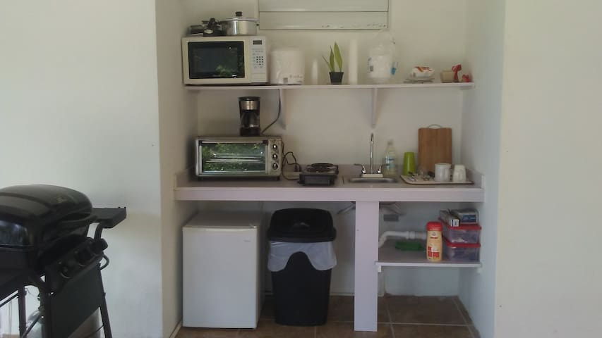 Kitchen with minifridge, double burner, oven, toaster, microwave, coffee maker, bbq, plates, utensils and condiments.  If you need anything else, just ask!!