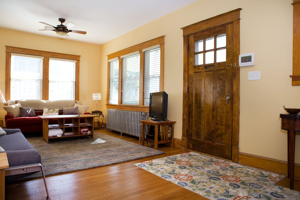 Classic wood front door opens to foyer with coat rack, space for shoes and a place for that heavy briefcase