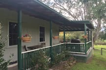 View towards covered verandah with outdoor eating area and gas BBQ