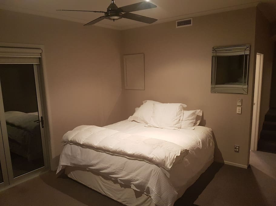 Super King bed with ceiling fan and gas central heating system for comfort