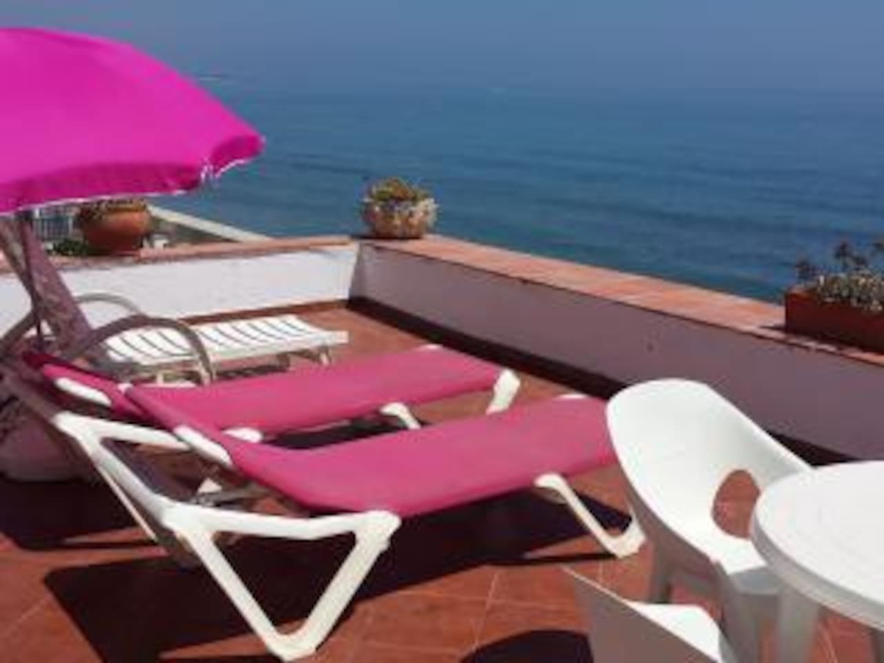 Top terrace with sun loungers BBQ and full sea view