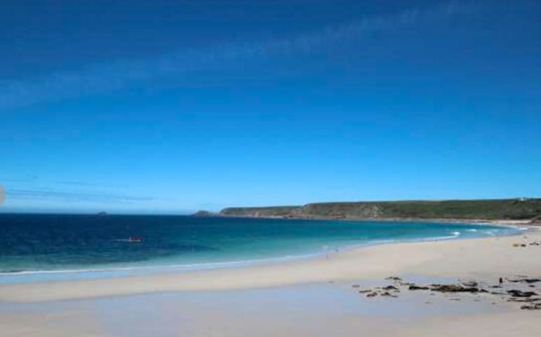 Sennen Cove beach, with Cape Cornwall in the distance.
